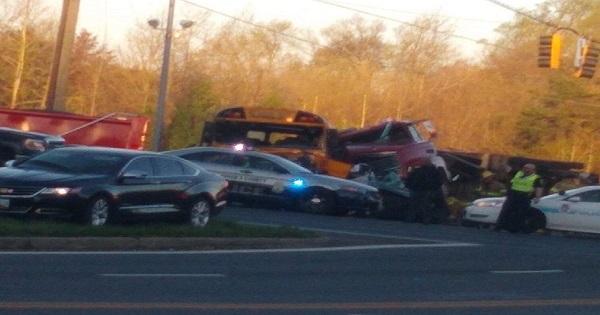 Fatal crash involving school bus, tractor-trailer in Clinton