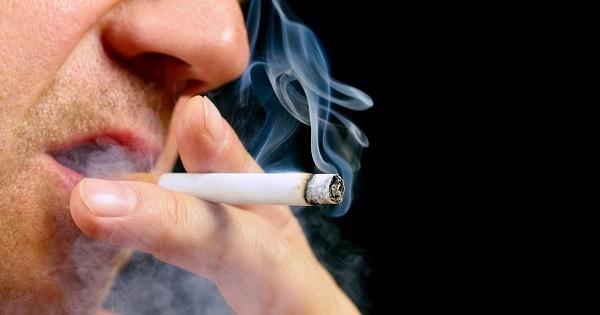 Senior-male-smoking-cigarette-on-black-background