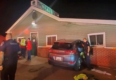 Driver goes through a wall at Green Door, barely misses hitting the band