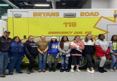Bryans Road Volunteers team up with local Girl Scouts to help them earn their merit badge