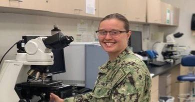 Petty Officer 2nd Class Kathleen Ferris helps the Navy Medical Readiness Training Command Patuxent River fight Coronavirus